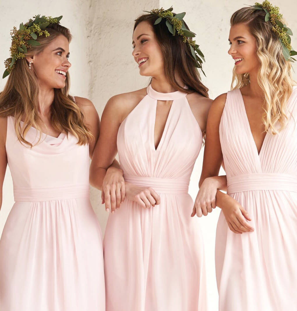 Models wearing pink J&B bridesmaids dresses