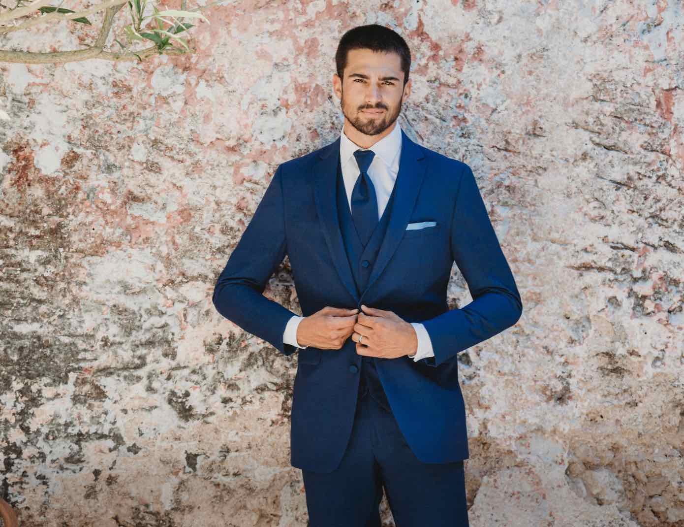 Male model wearing a dark blue tuxedo