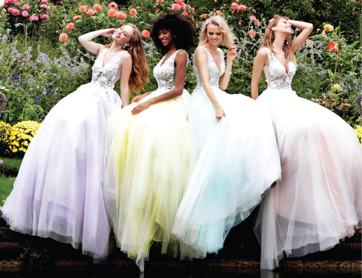 Models wearing colorful evening dresses
